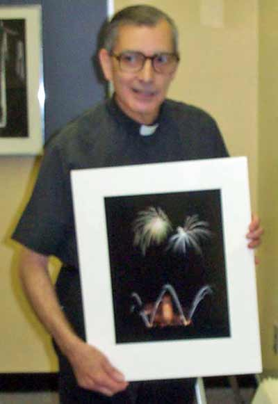 Fr Emmanuel Carreira with one of his photos
