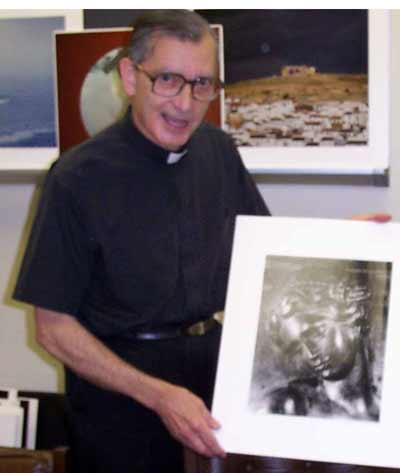 Fr Carreira with one of his photos